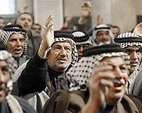 File photo of Shiites celebrating their electoral vistory in the recent Iraqi elections. Photo courtesy AFP.