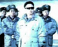 File image of Kim and his gang doing a tour of the 'frontline' at New Year.