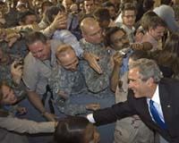 File photo of President Bush with US Soldiers. Photo courtesy AFP.